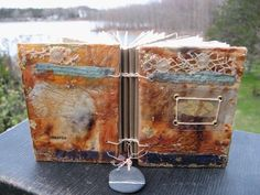 """Lunaria handmade book by Elizabeth Bunsen - 3 x 4"""", Coptic bound, 5 signatures, 40 pages of mixed archival heavy papers, mixed media  encaustic collage, the bee's knees and a found wing creme brulee and grandma's penuche"""