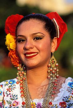SuperStock - Mexico, state of Yucatan, a Mexican woman wearing a traditional costume
