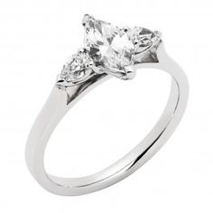 Marquise and pear cut diamond trilogy ring