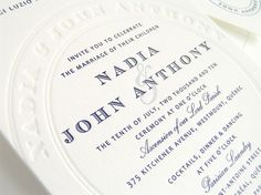 Navy and ivory wedding invite. Very classic and alludes to the wedding color