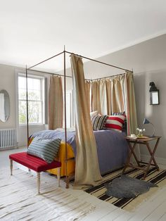 What a sight for your eyes, a bed covered in Hung with antique mangle-cloth drapes, with cushions covered in vintage Swedish… Bedroom Furniture, Bedroom Decor, Bedroom Ideas, Bedroom Modern, Master Bedroom, Bedroom Hacks, Bedroom Designs, Bedroom Inspiration, Paint And Paper Library