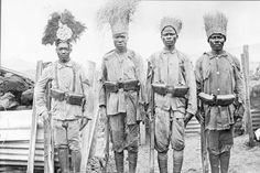 Four Askari colonial soldiers in service to the German Empire pose for a photograph while stationed in the Empire's East Africa colony during the Great War.