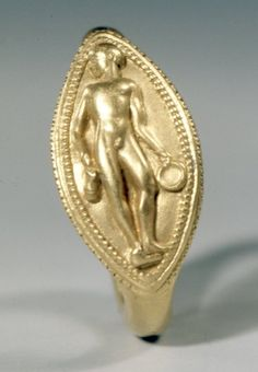 Gold finger-ring, decorated in high relief with a youth with a jug and phiale. 500-475 BC Etruscan(?)/Italtic(?) (Source: The British Museum)
