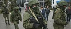 """Russian troops and gunmen in unmarked uniforms fan out across Crimea, seizing two airports in an apparent bid to assert dominance over the region. President Obama warns Russia there would be """"costs for any military intervention. Ukraine News, Military Intervention, Call Up, Vietnam War Photos, Al Jazeera, Russian Federation, Latest World News, Troops, Soldiers"""