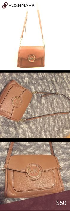 """Authentic Michael Kors cross body Small cross body bag with gold hardware. Measures 9"""" across and 7"""" long. Strap measures 22"""" long (shortest) to 25"""" long (longest) with adjustable lengths. Slight creasing as shown in pictures due to wear and storage. No stains or damages to inside and no markings on leather. Very light scratching on MK monogram Michael Kors Bags Crossbody Bags"""