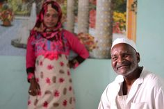 Smiling old nubian father with his daughter Fawzeyya.