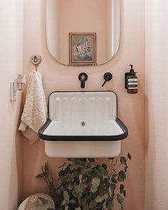 This townhome is a minimal, modern, monochromatic dream house with a pop of pink in its small bathroom. diy Dream house A Modern, Otherwise Monochrome Home Has a Precious Pink Guest Washroom Blush Bathroom, Diy Bathroom, Bathroom Ideas, Bathroom Organization, Master Bathrooms, Remodel Bathroom, Bathroom Mirrors, Bathroom Cabinets, Bathroom Storage