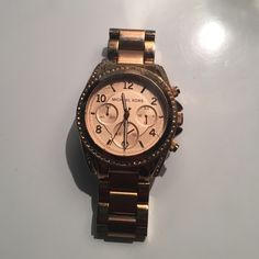 Michael Kors Watch Gently used Rose gold Michael Kors women's wristwatch. Just needs a new battery! Also have extra links. Michael Kors Accessories Watches