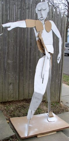 Very cool... Standing Man. Teacher's sample. Cardboard, glue. Middle school students of the Westfield Summer Workshop for the Arts made free-standing cardboard sculptures.