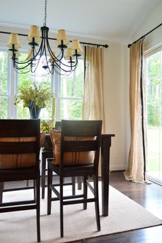 glue black ribbon to burlap curtains for an upscale rustic look