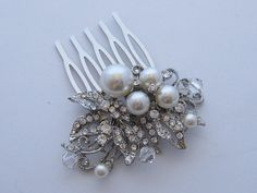 Hey, I found this really awesome Etsy listing at http://www.etsy.com/listing/120722494/vintage-inspired-pearls-bridal-hair