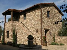Cultured stone veneer with a Spanish tile roof.  Timeless look!
