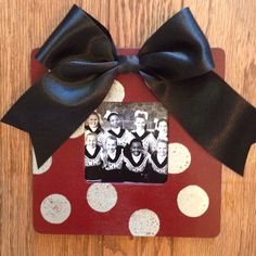 Cheer gift for the girls.  Spray painted unfinished wood frames, used round stencil sponge for the polka dots using metallic paint and attached a big bow with hot glue.