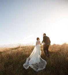Cara's bespoke wedding veil in a field