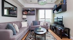 Whether it's a studio, a one-bedroom unit, or a loft-type home, there's a lot you can do to make it your own Living Area, Living Spaces, Gray Sofa, House And Home Magazine, One Bedroom, Floor Rugs, Small Spaces, Love Seat, Condo