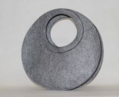 Fresh, clean design. Wish it was available in more colors! Round grey handbag in heavyweight felt by JaneClarbour on Etsy