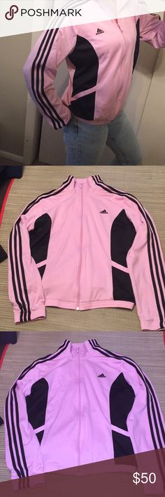Vtg Adidas Track Jacket RARE pink black womens L price firm super rare color vintage adidas pink and black 3 stripe track jacket. Light pink with black stripes front pockets and inner hidden pockets with zippers. Retro sz women's L , however , fits more like a medium-Large to me. If your more of a L-XL may be too small I am a sz small modeling . Perfect with a pair of Adidas sneakers for 2017. Lightweight windbreaker track jacket no stains or holes , a few loose threads not bad - see last…