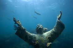 """Original """"Cristo degli Abissi"""" ~ This underwater statue of Jesus is located in the Mediterranean Sea off San Fruttuoso between Camogli & Portofino. The sculpture was created by Guido Galletti after an idea of Italian diver Duilio Marcante. The statue was placed near the spot where Dario Gonzatti (first Italian to use scuba gear) died in 1947. It depicts Christ in a pose offering a blessing of peace."""" The statue was recently restored in 2003, but maintains much of its corroded deteriorating…"""