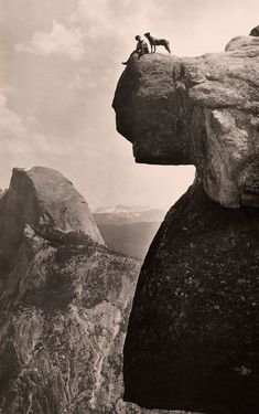 A man and his dog on the Overhanging Rock in Yosemite National Park, May 1924. PHOTOGRAPH BY EDUCATIONAL-BRUCE PHOTOGRAPH