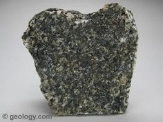 Gabbro is a coarse-grained, dark colored, intrusive igneous rock that contains feldspar, augite and sometimes olivine. The specimen shown above is about two inches (five centimeters) across. Cheap Countertops, Formica Countertops, Minerals And Gemstones, Rocks And Minerals, Raw Gemstones, Crystals Minerals, How To Clean Granite, Formations Rocheuses, Kitchen Ikea