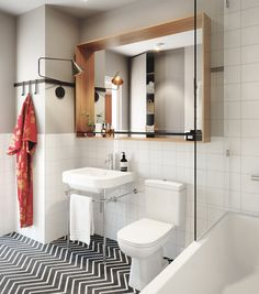 Beautiful white and black bathroom with large mirror and hanging robe