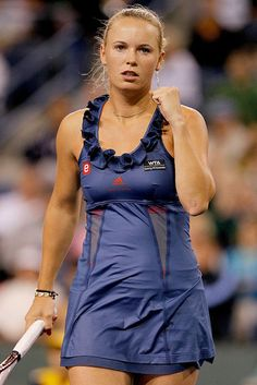 Caroline Wozniacki debuted Adidas by Stella McCartney Tennis Ruffle Dress in blue for the opening match at Indian Wells in 2011.