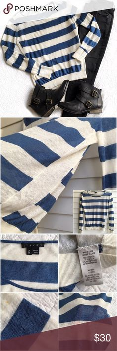 Theory Striped Sweater Blue and white striped sweater.  Very lightweight and semi sheer. There are tiny spots on one arm but not noticeable at all.  Priced to reflect. The size on the tag is TP which is an XS petite. Theory Sweaters