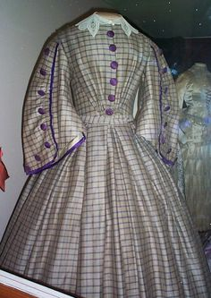 1860s day dress coloured with the new aniline chemical purple dye which gave far richer colour than vegetable dye