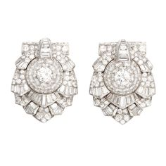 A pair of superb diamond double clips by Cartier. Containing Old Mine diamonds, emerald cuts and baguettes totaling aprox 19.50 carats. Both signed Cartier London with Cartier Makers Marks, & French Hallmarks. Made in Paris workshop retailed for London branch. Set on Platinum. Circa 1930