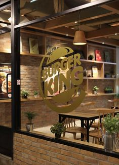 "With natural, rustic materials and a communal vibe, this restaurant looks  more like a vegetarian cafe than the home of the Whopper.  Fast-food joints are embracing high design as first McDonald's recently  enlisted Patrick Noguet to design their new family-restaurant concept in  France, now Burger King is getting in on the act, with a garden-patio theme  intended to appeal to both families and teens alike. ""We noticed that one  word that kept popping up was 'flame grilled,' and we used…"