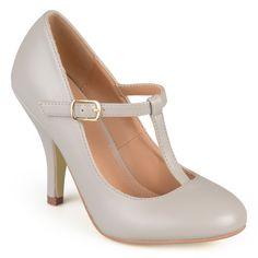 Look chic and polished in classic Mary Jane pumps from Journee Collection. These high-heel shoes features smooth PU uppers with a t-strap design on the vamps. A modest heel and round toes add to the versatile design.