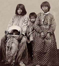 Paiute women and children. Photographed: 1865.