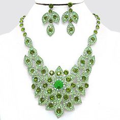 Elegant Design Green Crystal Pave Rhodium Silver Bib Collar Necklace Earring Set. Get the lowest price on Elegant Design Green Crystal Pave Rhodium Silver Bib Collar Necklace Earring Set and other fabulous designer clothing and accessories! Shop Tradesy now