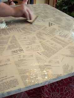 Use a old cookbook as your countertop! MDF board cut to size and put your cookbook pages all over the board and coat with Envirotex