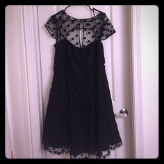 Black party dress with sweetheart neckline Worn only one time! This black on black party dress has black polka dots and a sheer cap sleeve. Natural waist is very flattering, and skirt flutters away from body. Fully lined with crinoline skirt. Size XL in City Chic brand recommended for size 22, but I wore as a 24/26. This brand is currently sold in Macy's, Bloomingdales, & Nordstroms. City Chic Dresses