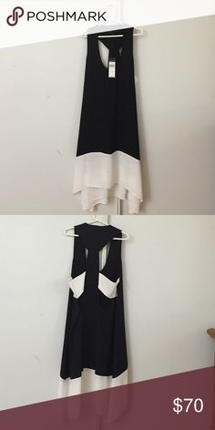 💝BCBGMAXAZRIA Dress 💝 Brand new with tags. Mid length. Super sexy in the back. Size XSmall. Lined.The only flaw is the tiny lip stain at the bottom but can be easily cleaned. Besides that, perfect condition.❤️❤️❤️ BCBGMaxAzria Dresses Asymmetrical