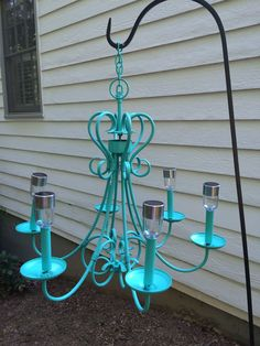 Outdoor solar chandelier - bought an old rusty antique store chandelier and repainted, glued in the tops of some cheap solar lights, and hung from a shepherd's hook near our deck