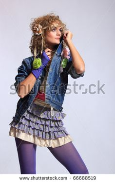 80's Fashion woman over gray background by Netfalls - Remy Musser, via ShutterStock