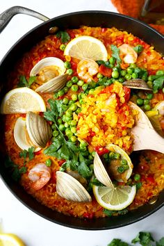 Easy Seafood Paella Recipe - A smoky and Easy Seafood Paella Recipe that looks and tastes like a sun-soaked summer on the Mediterranean in Spain! Recipe, rice, dinner, clams, shrimp, saffron | http://pickledplum.com