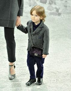 3-year old Hudson Kroenig walked for Chanel runway again this season, holding the hand of Heidi Mount