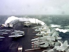 USS John C Stennis in heavy weather.  Takes some serious sea state to whitecap over the bow of a freaking aircraft carrier!