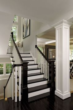 Black laquered floors on Side stair tower against white panneling= chic & modern. Opal Homes. Interior Stairs, House Design, Decor, Remodel, House, Interior Columns, Home Remodeling, Stairs, Home