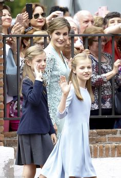Queen Letizia stunned in a green coatdress with lace embellishment and her daughters proved their fast growing up to resemble their mother