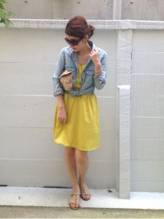 Denim shirt over a summer dress
