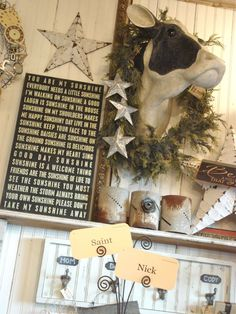 LOVE this cow head wreath, antiqued candle holders, rustic stars sign etc ... ! Rustic design