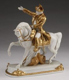 "Early 20th century German polychrome decorated porcelain figurine, modeled as Napoleon a Cherbourg, manufactured by Scheibe Alsbach, 11""h x 9""l x 4.5""w."