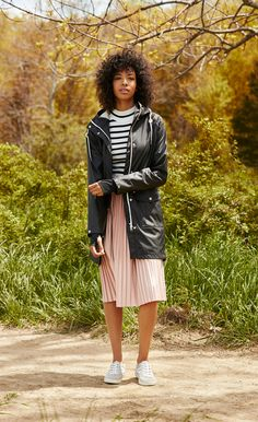 Style a pleated skirt with a striped sweater and Tretorn sneakers for a laid-back yet put-together look. #ad