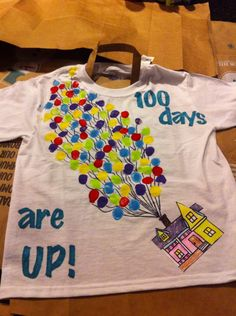 100 days t-shirt UP balloons. Eric used his thumb dipped in paint.