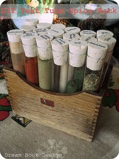 A DIY test tube spice rack. Makes such an awesome gift for the Holidays! And it only cost $18 to make!