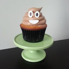 I made a poo emoji cupcake! Because that's what happens when you use a round pastry tip with chocolate frosting. It looks like poo.
